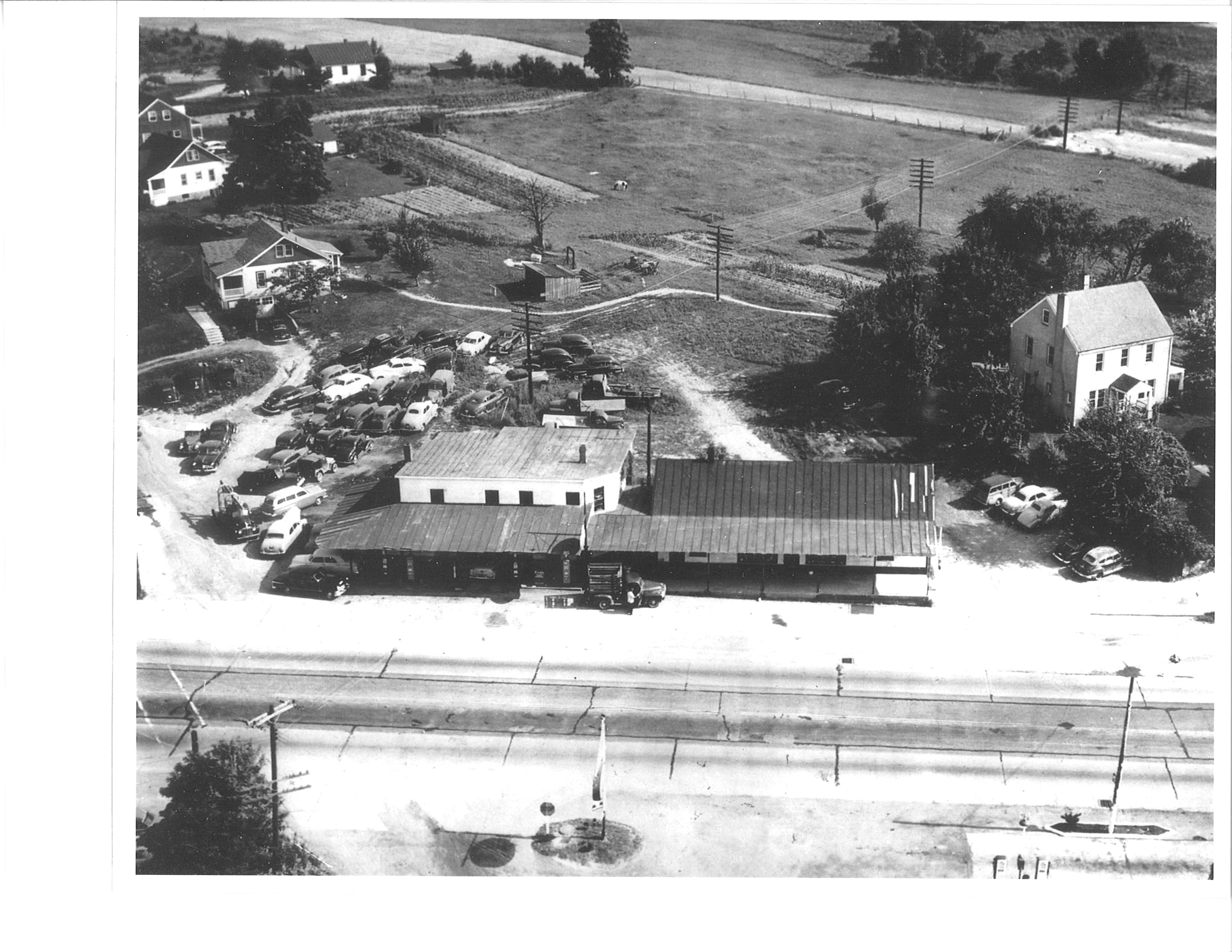 Menefee's Garage, one of a number of service stations in town. Menefee's can be found on Mildred's map.