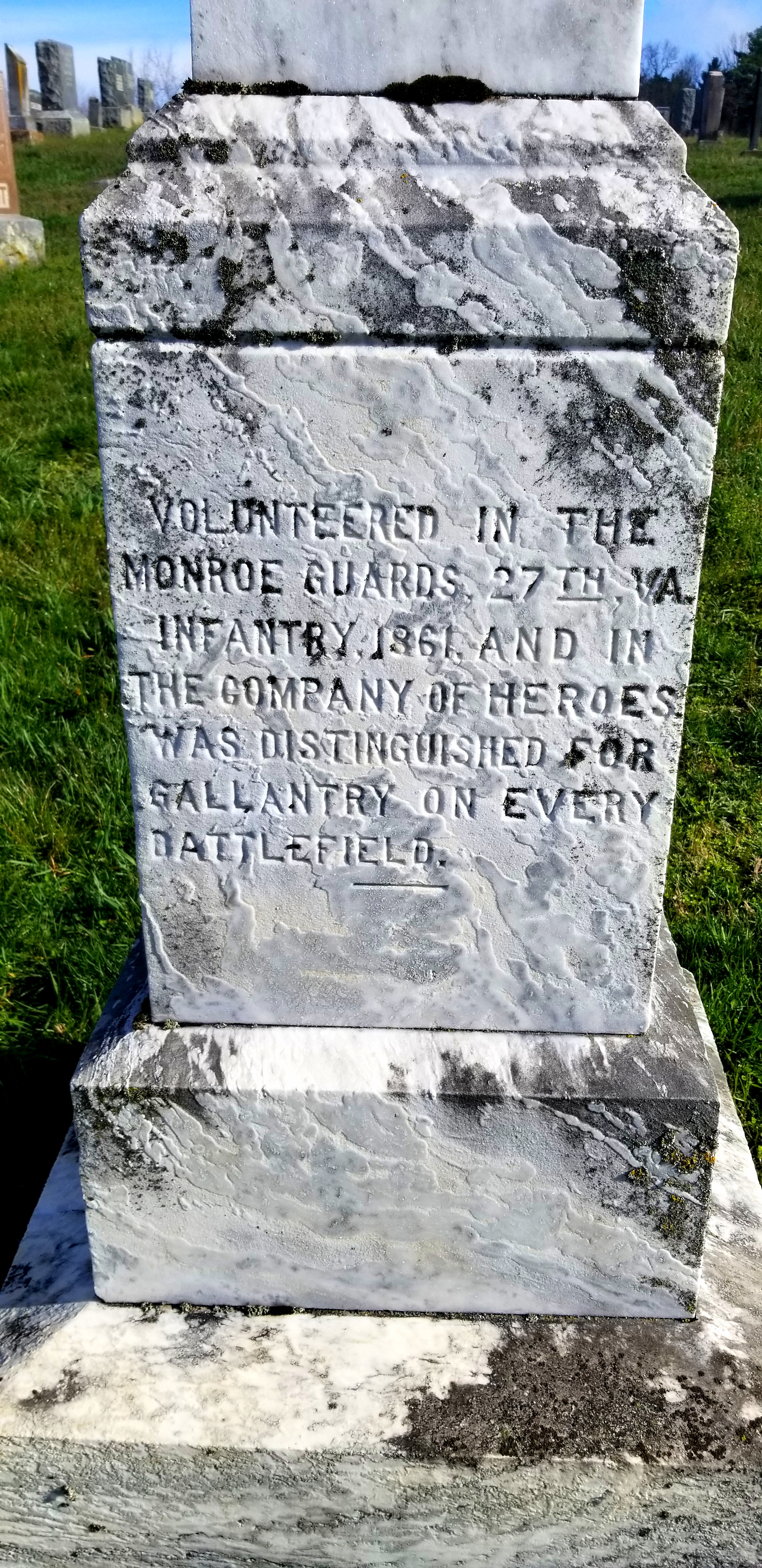 close up on the left side of the memorial. It informs readers that Foster served in the Monroe Guard 27th V.A. division.