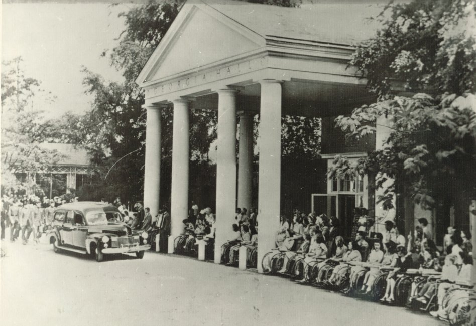 Polio patients line-up at the Georgia Hall to watch the hearse carrying the coffin of President Roosevelt leave the Georgia Warm Springs Foundation. April 13, 1945.