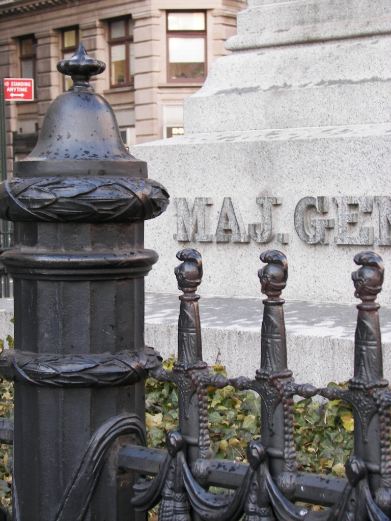 A close-up of the ornamental fence (with replica Congressional Sword of Honor pickets) surrounding the monument