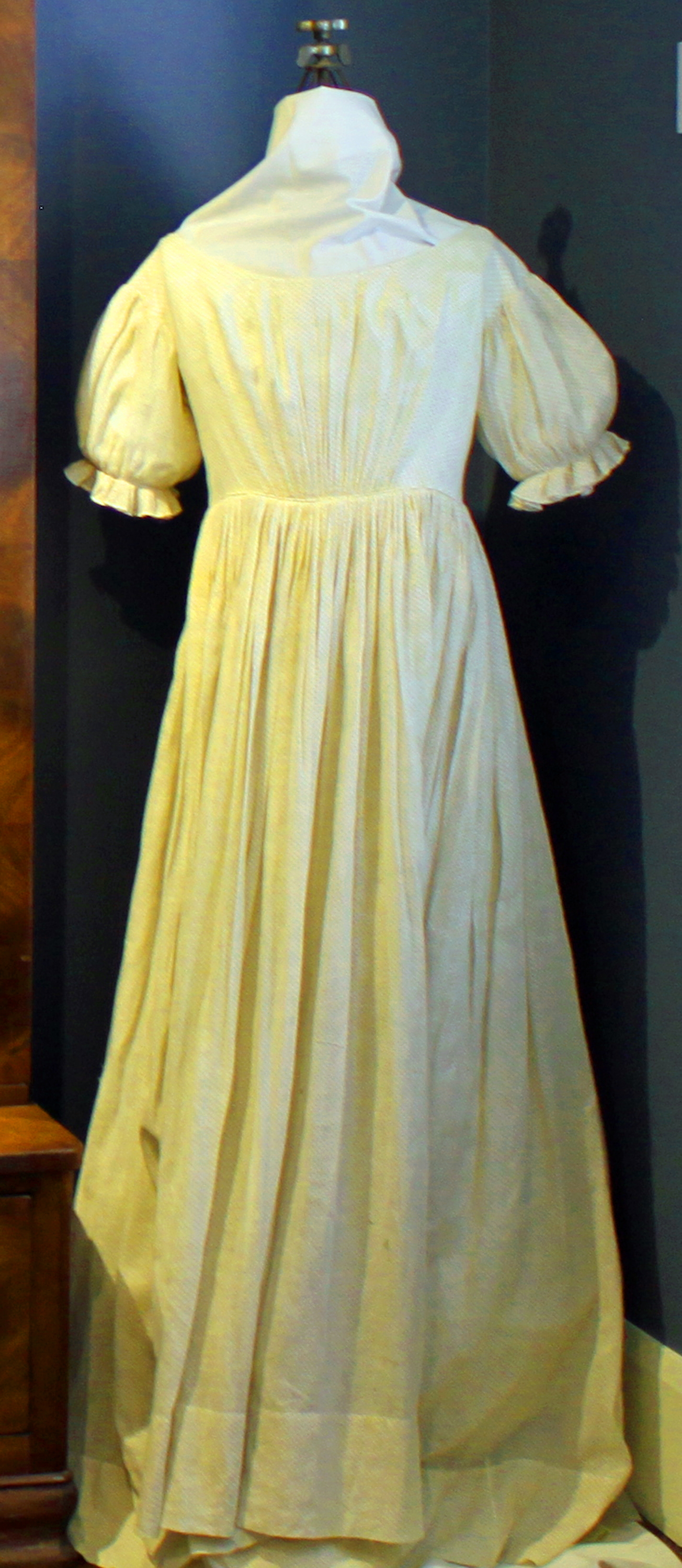 Cotton dress made by Lucy Pier Stevens while in Texas visiting her Aunt Lucy Merry Pier and Uncle James Bradford Pier. Lucy Stevens arrived in Texas on Christmas Day 1859 and because of the outbreak of the Civil War in 1861, she was trapped in Texas until she was able to escape on a Confederate blockade runner's ship on April 17, 1865. Lucy arrived safely in Ohio on May 4, 1865 with this dress.