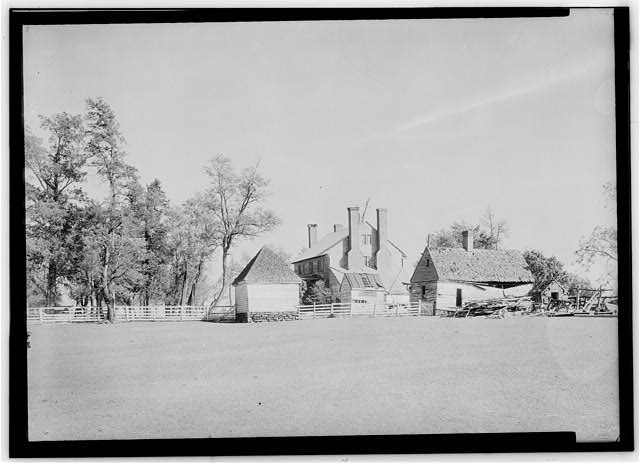 Photograph of smokehouse, Effingham main house, and slave quarters ca. 1930s