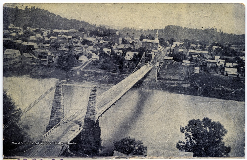The original suspension bridge from Morgantown to Westover in 1856, two years after its construction.