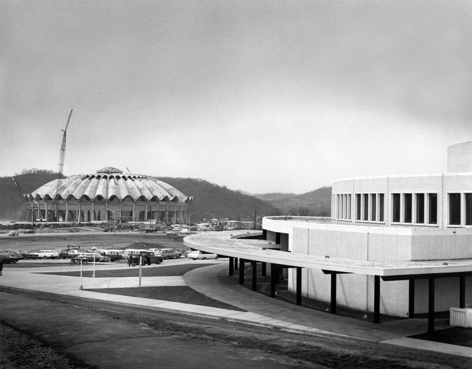 The CAC completed in the foreground while the Coliseum is being built in the background.