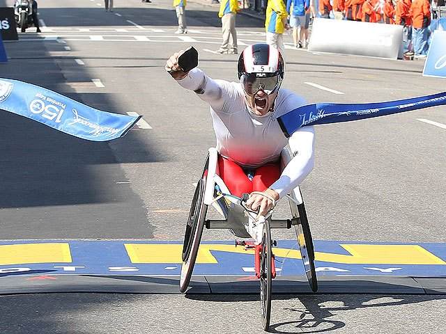 Despite record heat, Josh Cassidy of Canada wins the marathon, breaking the course record.