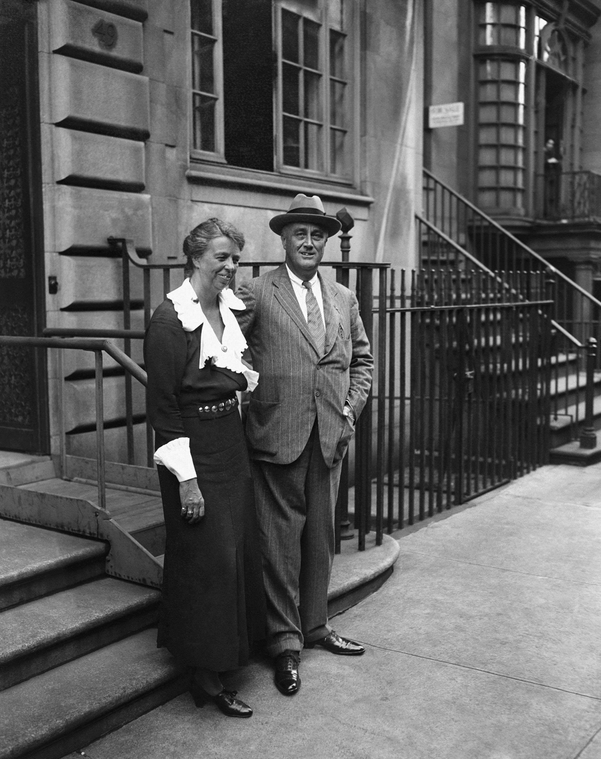 President Franklin D. Roosevelt and first lady Eleanor Roosevelt standing in front of their home located on East 65th St. in New York, 1933