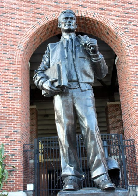 Nile Kinnick Statue in front of the main entrance into Kinnick Stadium. The statue is part of a tradition for the football team, as they touch the helmet walking into the stadium before a game.