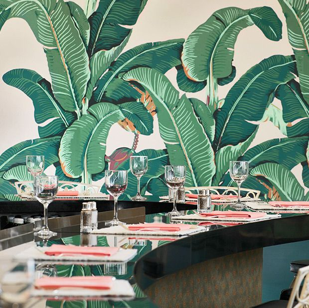 "The Fountain Room coffee shop featuring the banana leaf wallpaper designed by Don Loper, known by the trademarked name ""Martinique"""