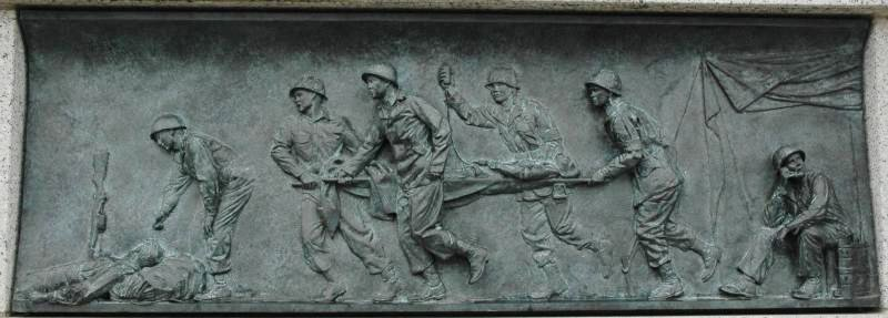24 bas-relief panels tell stories from the war, such as this image of a field hospital. Photo courtesy of the National Park Service.