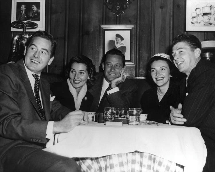 Don De Fore, Brenda Marshall (Mrs. William Holden), William Holden, and Nancy and Ronald Reagan at Chasen's Restaurant. Ronald Reagan proposed to Nancy Davis in Booth 2 at Chasen's in 1952.