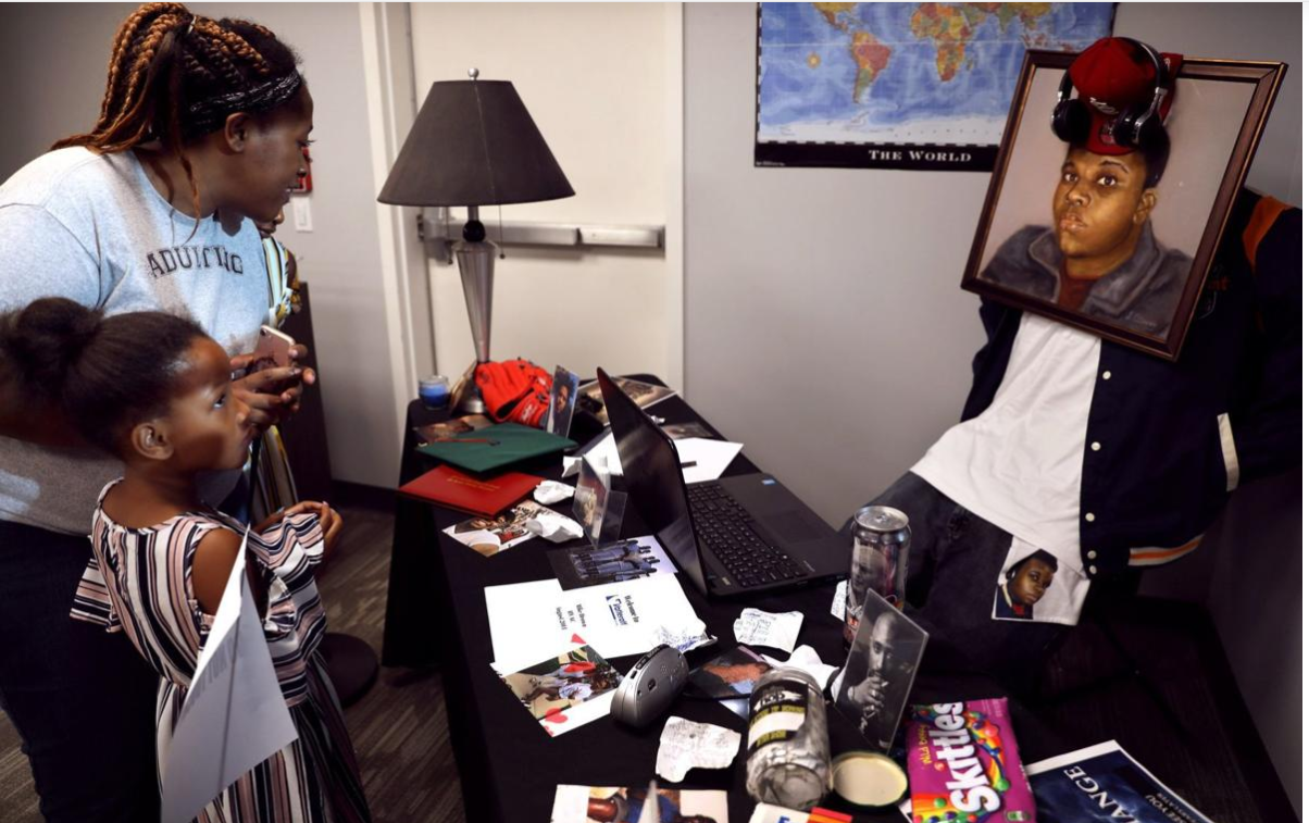 The art exhibit contains items found in Michael Brown's bedroom on the day of his death. These were added to the exhibit to show how Michael was a teenage boy who enjoyed drinking soda, eating skittles, and listening to music.