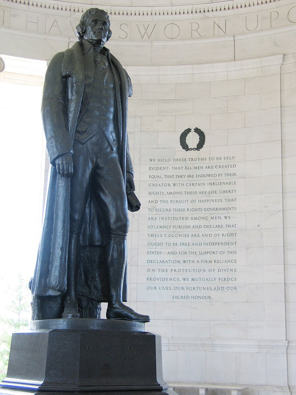 The 19-foot bronze statue of Thomas Jefferson stands by an engraving of the Declaration of Independence. Wikimedia Commons.