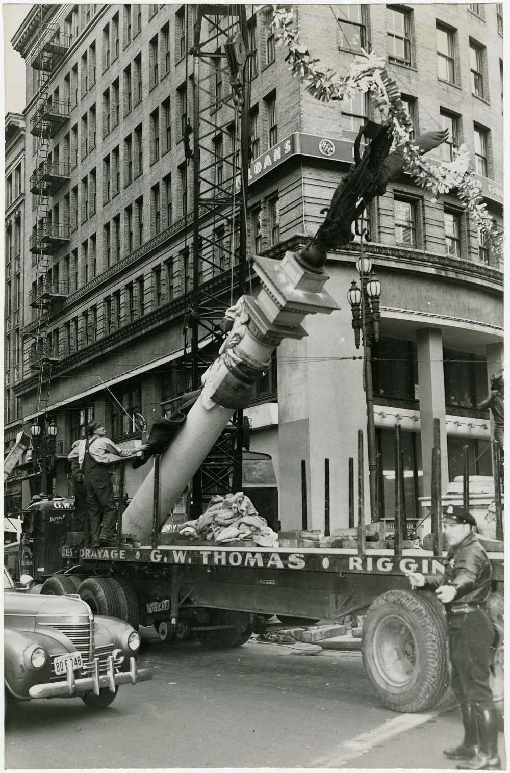 [Native Sons Statue being moved from Market, Turk and Mason streets to Golden Gate park]. December 29, 1948. Photo ID #AAA-9489. SAN FRANCISCO HISTORY CENTER, SAN FRANCISCO PUBLIC LIBRARY.