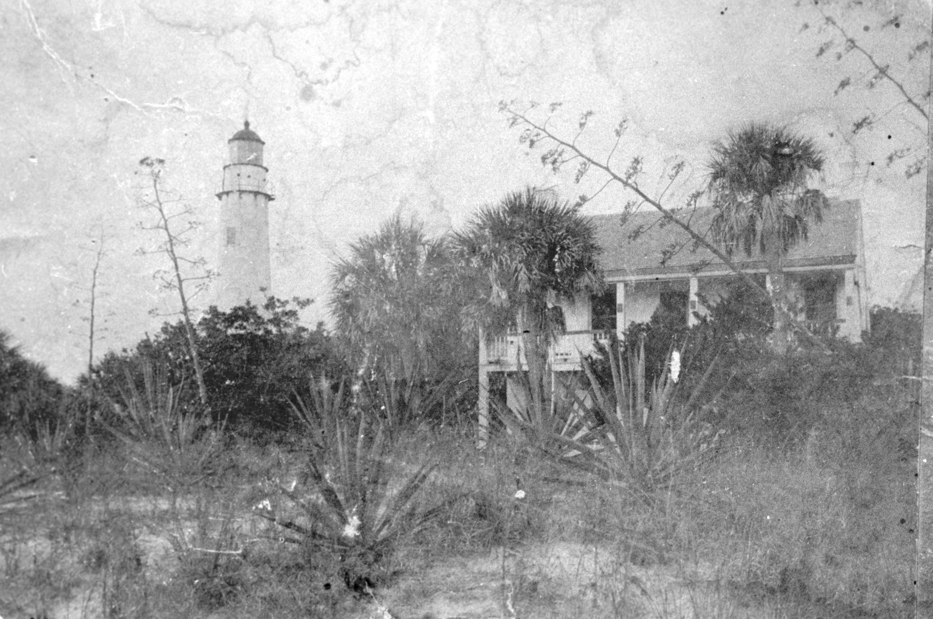 Egmont Key Lighthouse and keeper's house (ca. 1900-1910). Lighthouse keepers and their families lived close to their work in order to keep the light operating in all kinds of weather.
