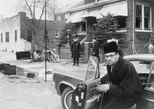 Malcolm X returning the home the day after it was firebombed