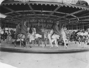 The Carousel at Lakewood Park in the 1930s. The executives of the Philadelphia Toboggan Company that created the hand painted horses in 1925 are to sitting atop the horses. Each horse is unique.