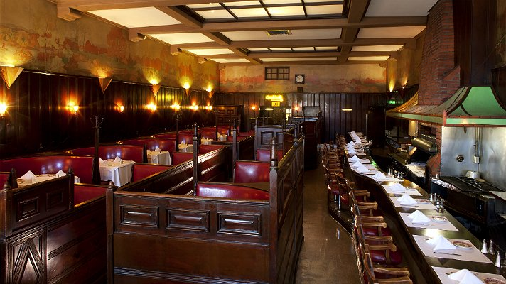 Musso and Frank dining room featuring the classic red leather booths