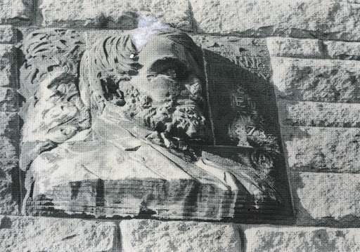 A close-up of the damaged bas-relief sculpture of Oliver Ames Jr.