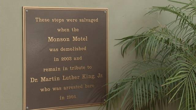 This plaque is located near the entrance to the Hilton and is next to the original steps where King and others were arrested.