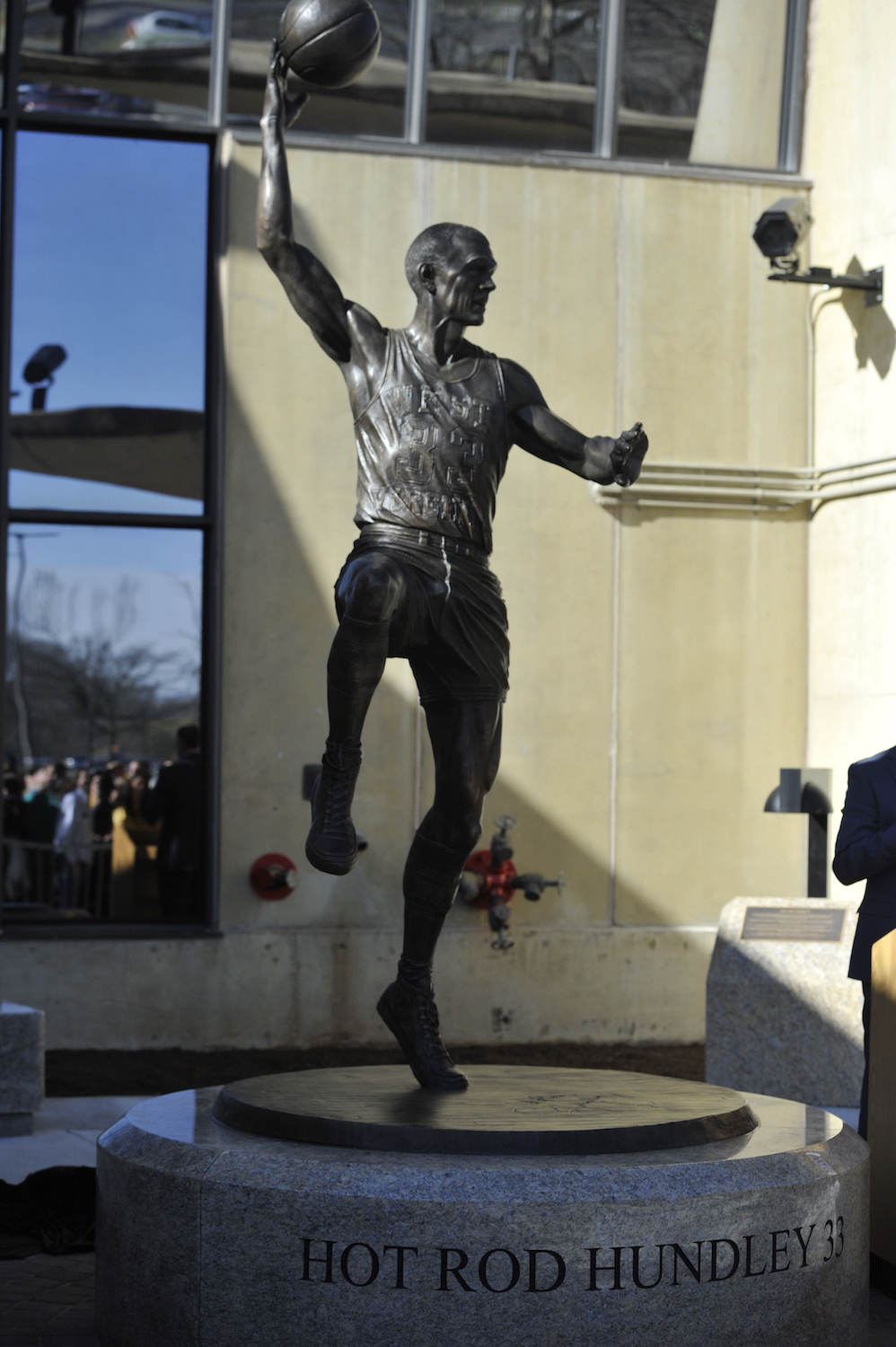 The Hot Rod Hundley statue at its unveiling ceremony, showing Hundley's infamous hook shot.
