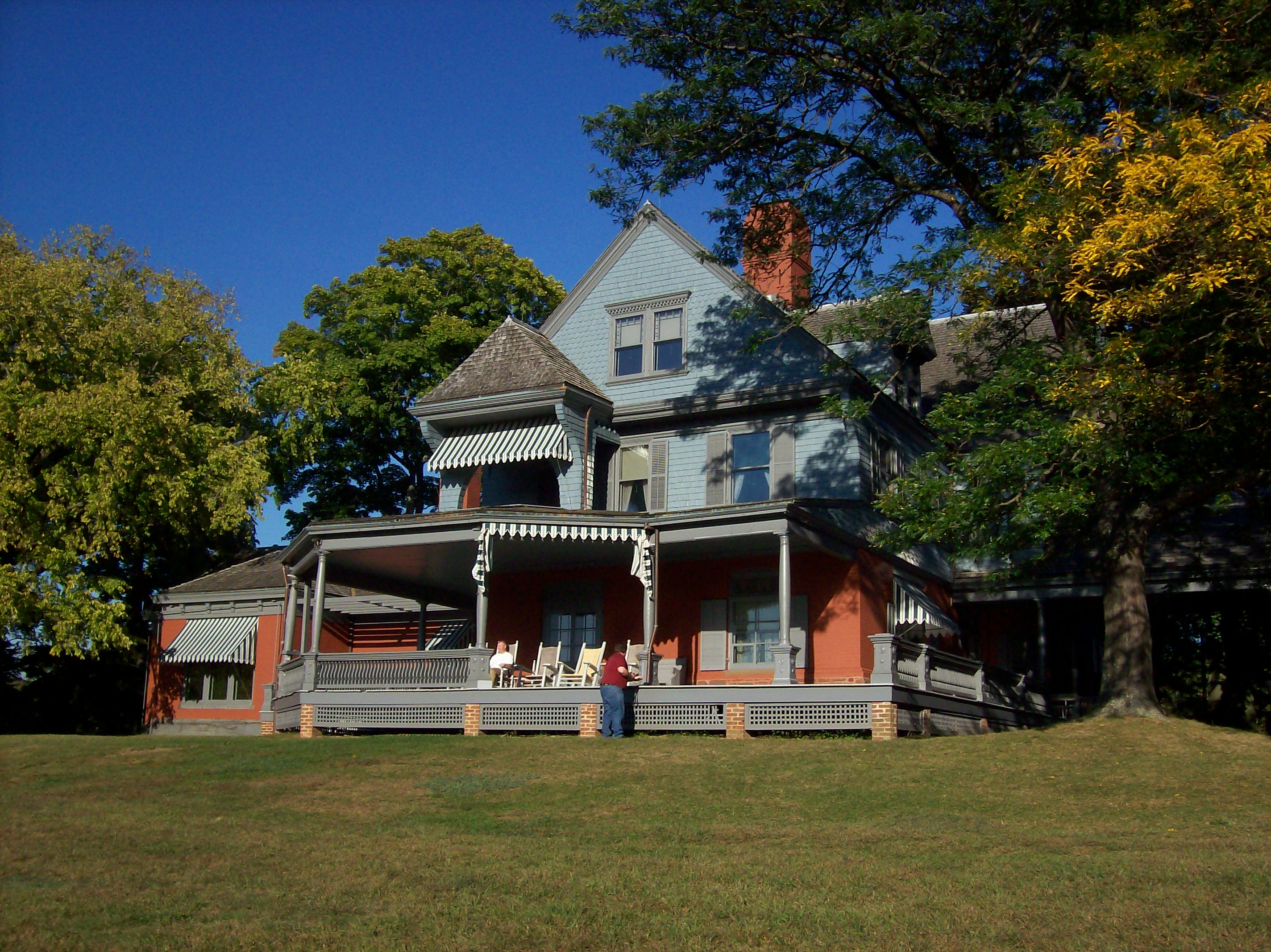 Theodore Roosevelt's Queen Anne style home Sagamore Hill. Guided tours are available for visitors to view many of Roosevelt's original furnishings, gifts from foreign dignitaries, and hunting prizes.