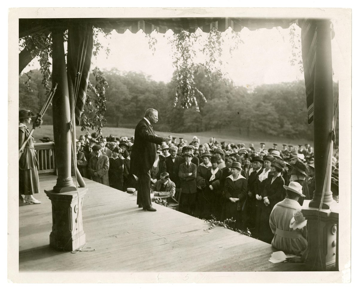 Theodore Roosevelt speaking to a crowd of women suffragist delegates on the porch of Sagamore Hill, 1917