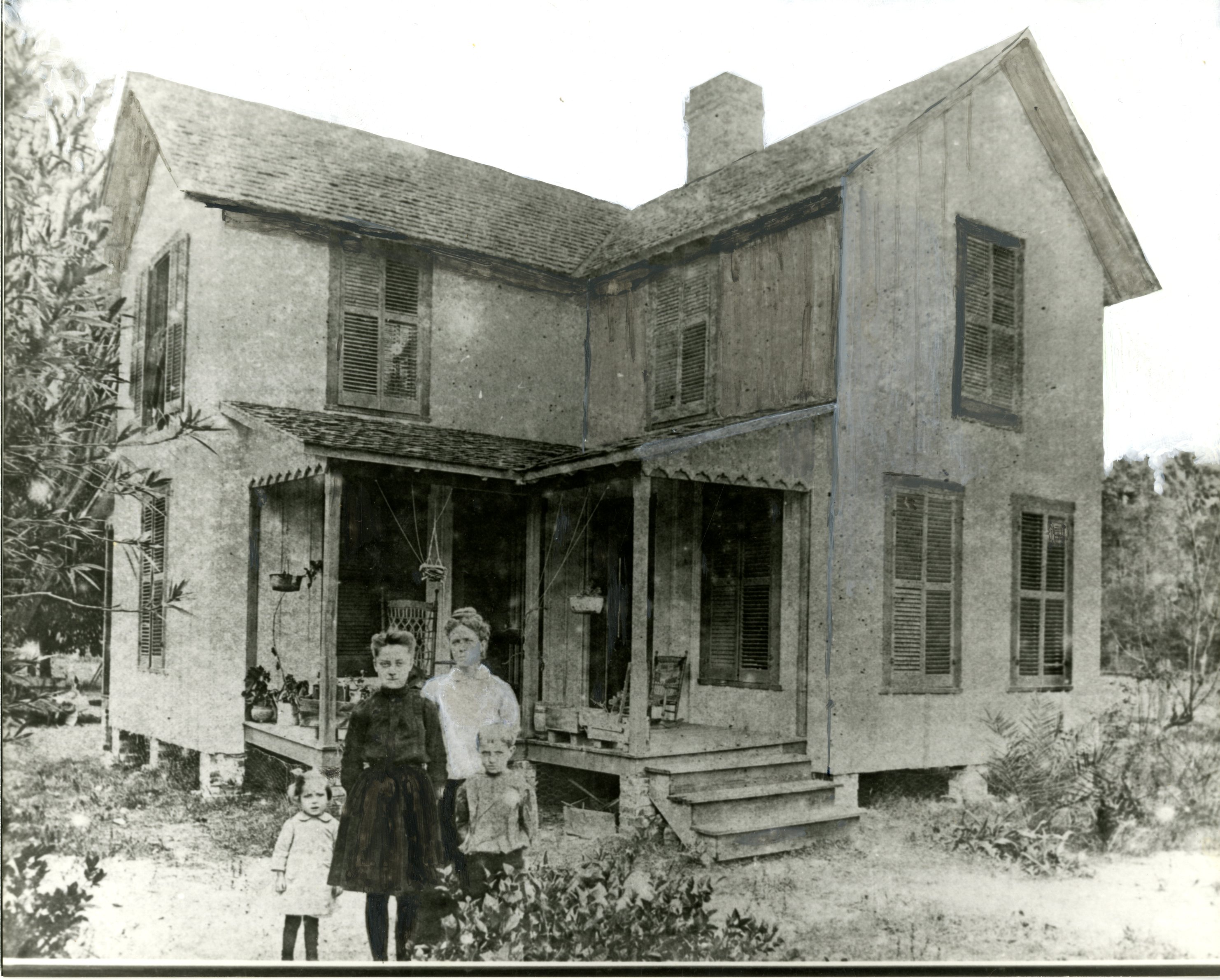Mary Louise Lowe and her children, Corinna, Laura, and Sumner stand in front of the Lowe House, Anona, Florida, circa 1906.
