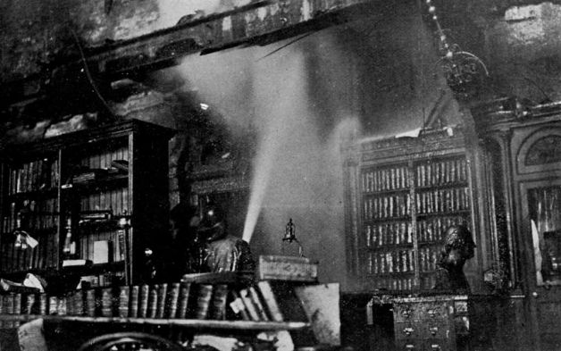 Firefighters control the blaze inside the capitol on March 29, 1911