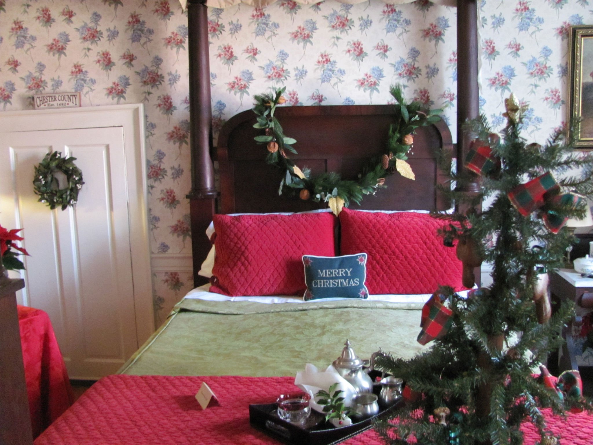 One of the bedrooms within the mansion decorated for the holidays.