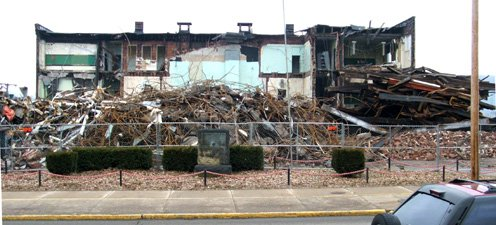 Demolition of Moundsville High School with marker in front.