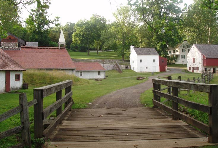 A wooden bridge ushers visitors into the Hopewell Furnace National Historic Site.