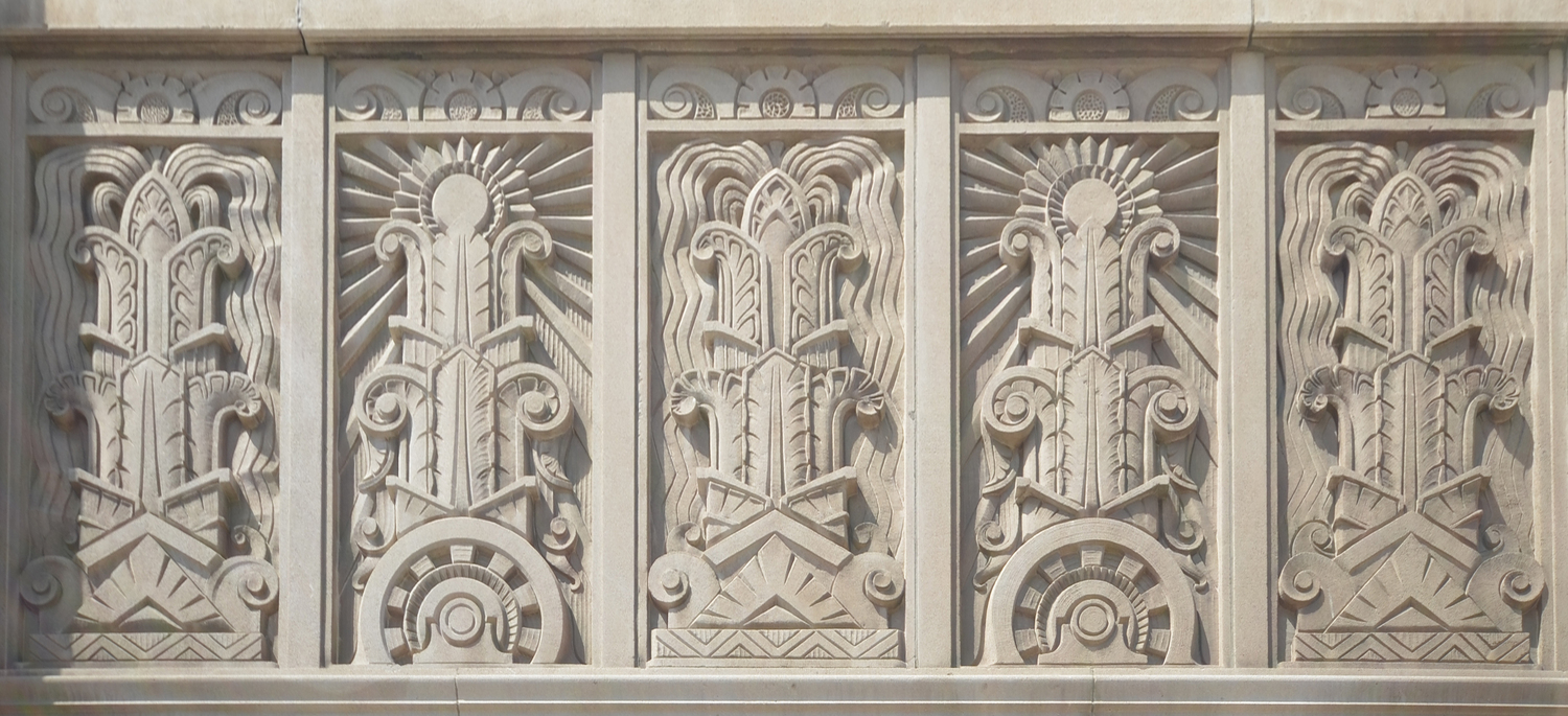 The building features elaborate ornamentation, including depictions of a sunbeam to reflect the KCP&L's role as a provider of light. Image obtained from Power & Light Apartments.