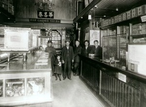 The photo shows the interior of Wah Chong Tai general store in 1905