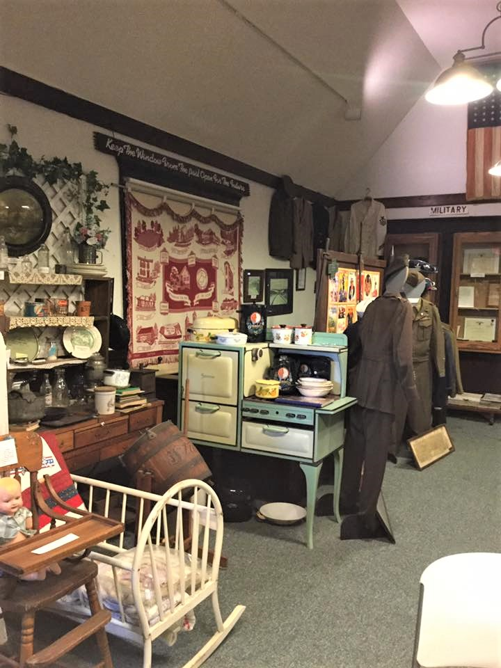 Antiques along with a military display that includes uniforms from various branches and time periods.