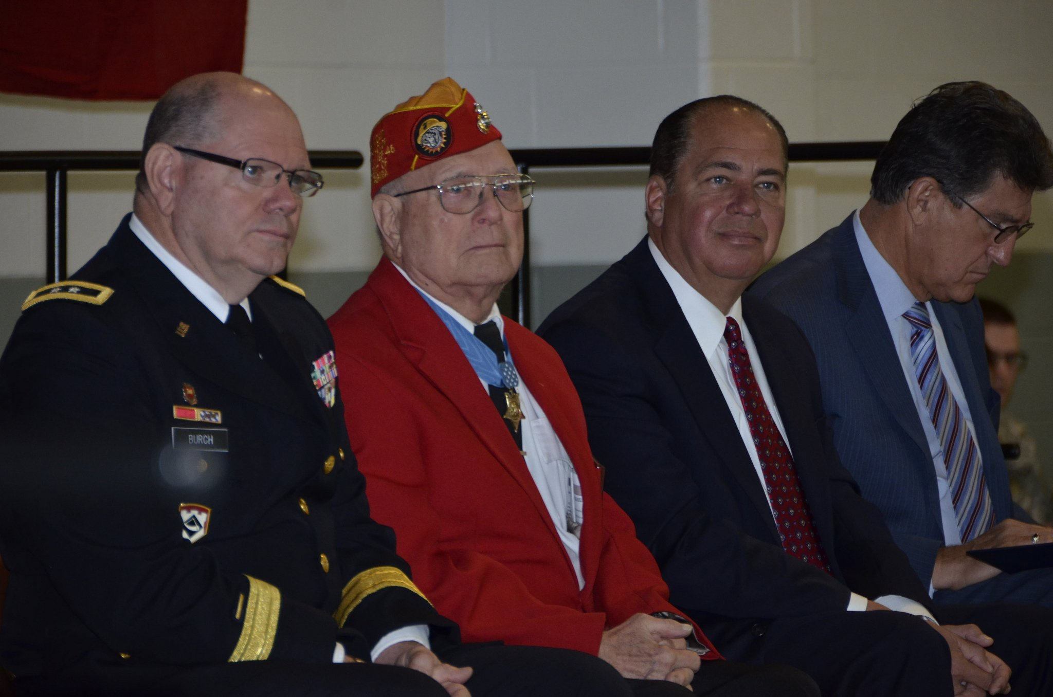 MG Burch, Woody Williams, Governor Tomblin, and Senator Manchin listen to the Adjutant General of the West Virginia National Guard speak at the dedication ceremony. Woody Williams is the only living Medal of Honor Recipient from Iwo Jima.