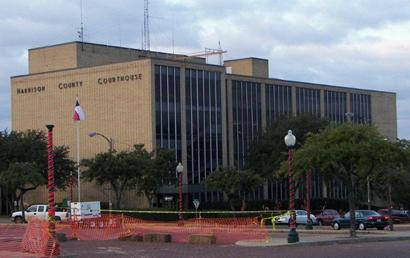 The current county courthouse is of a much more modern style and sits across the square from the original building.