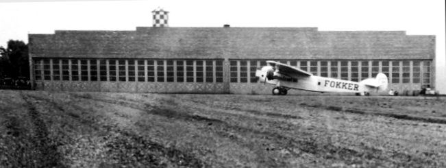 An April 1929 photo by J.E. Anderson of a Fokker Trimotor at Glen Dale Fokker Field, in front of the north end of the Fokker factory where it was built.