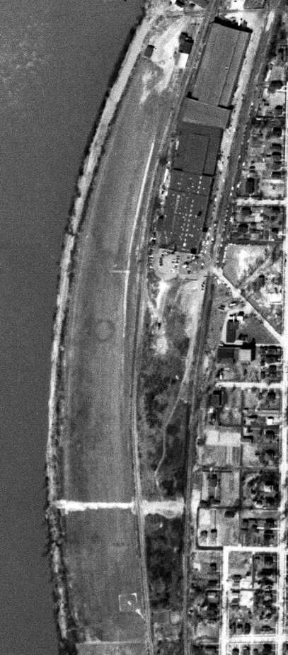 As seen in a circa 2001-2005 USGS aerial photo, a total of four hangars were located along the northeast side of the runway.