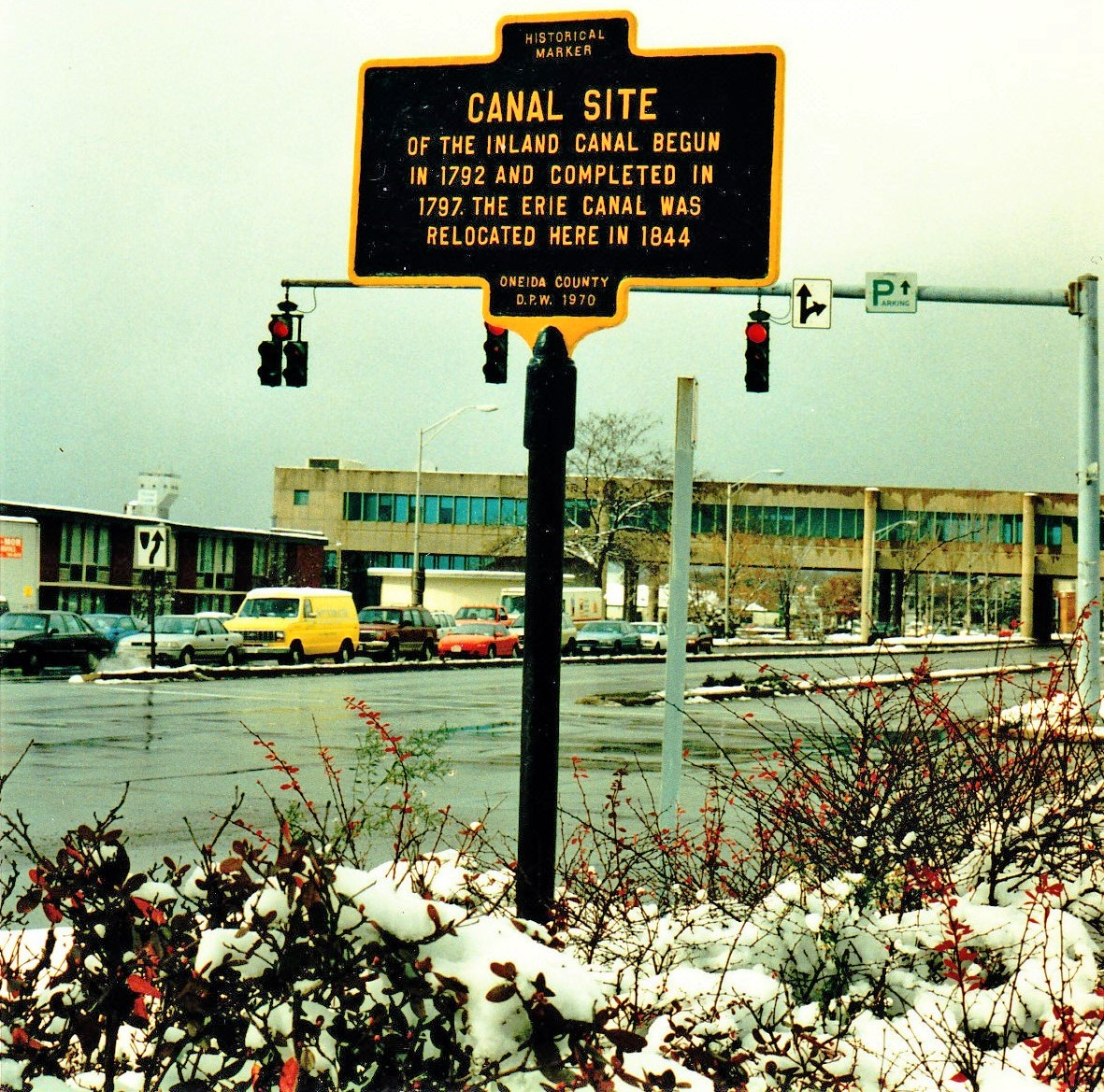 "This shows the marker as it was in the 1970s with the now demolished ""Living Bridge,"" an overhead walkway that once provided pedestrians a route over Erie Blvd., in the background, Image courtesy of Rome Historical Society."