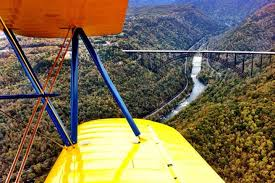 The view of the bridge over the New River Gorge from the Stearman