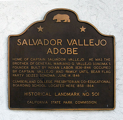 Plaque located outside adobe location. A brief history of the building.