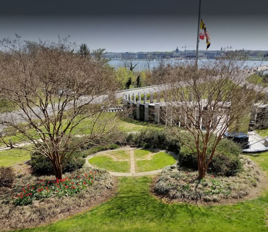 A semi birds eye view of the monument shadowing the Naval Academy
