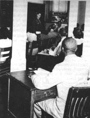 G. W. McLaurin enduring segregation within his courses at the University of Oklahoma
