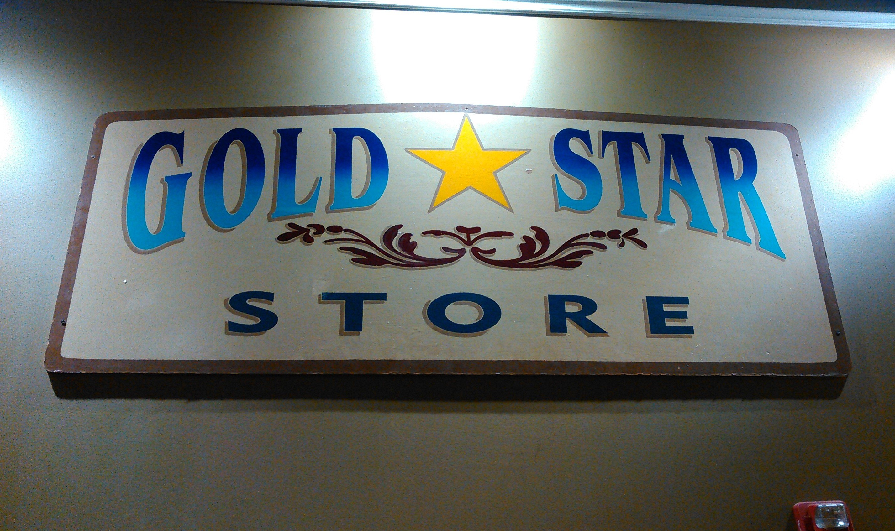 A sign from one of the previous occupants of the space, the Gold Star Store, which sold feed and farming supplies to local residents. Today it is displayed on the wall of Meatheads. Photo by Sofia Biegeleisen