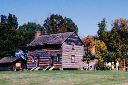 One of several historical replicas at the site, this log cabin similar to the one that was on the property and home to the Polk family