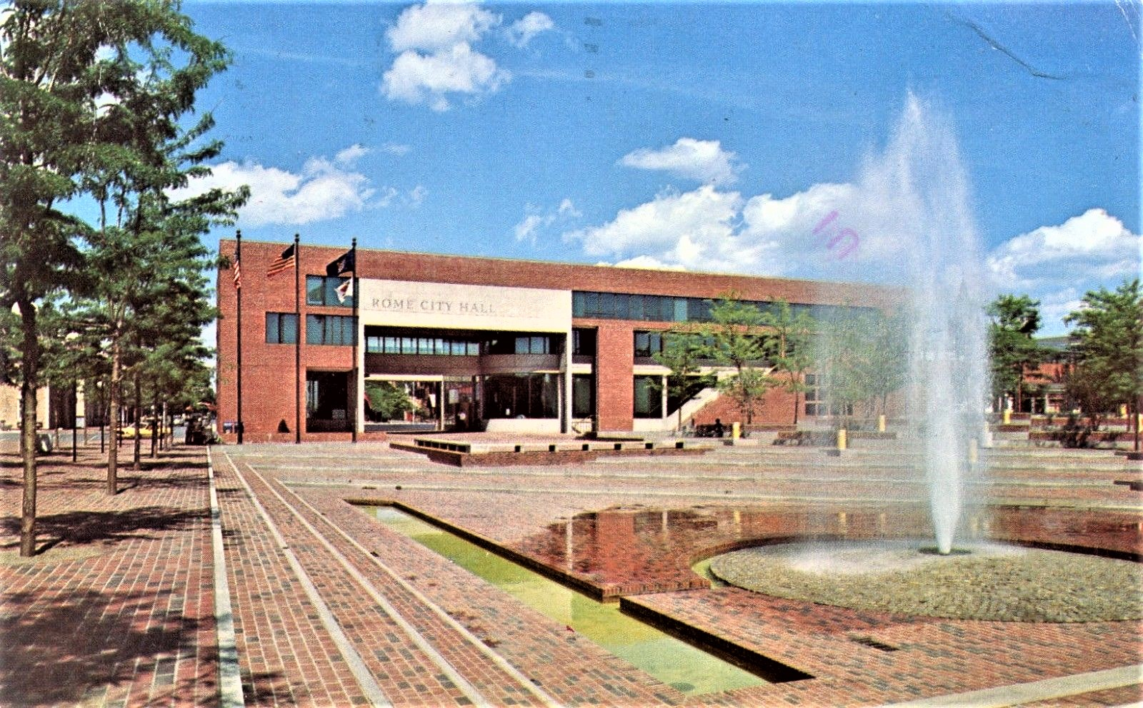 Liberty Plaza was brick-covered and had a fountain.  Image courtesy of Rome Historical Society.