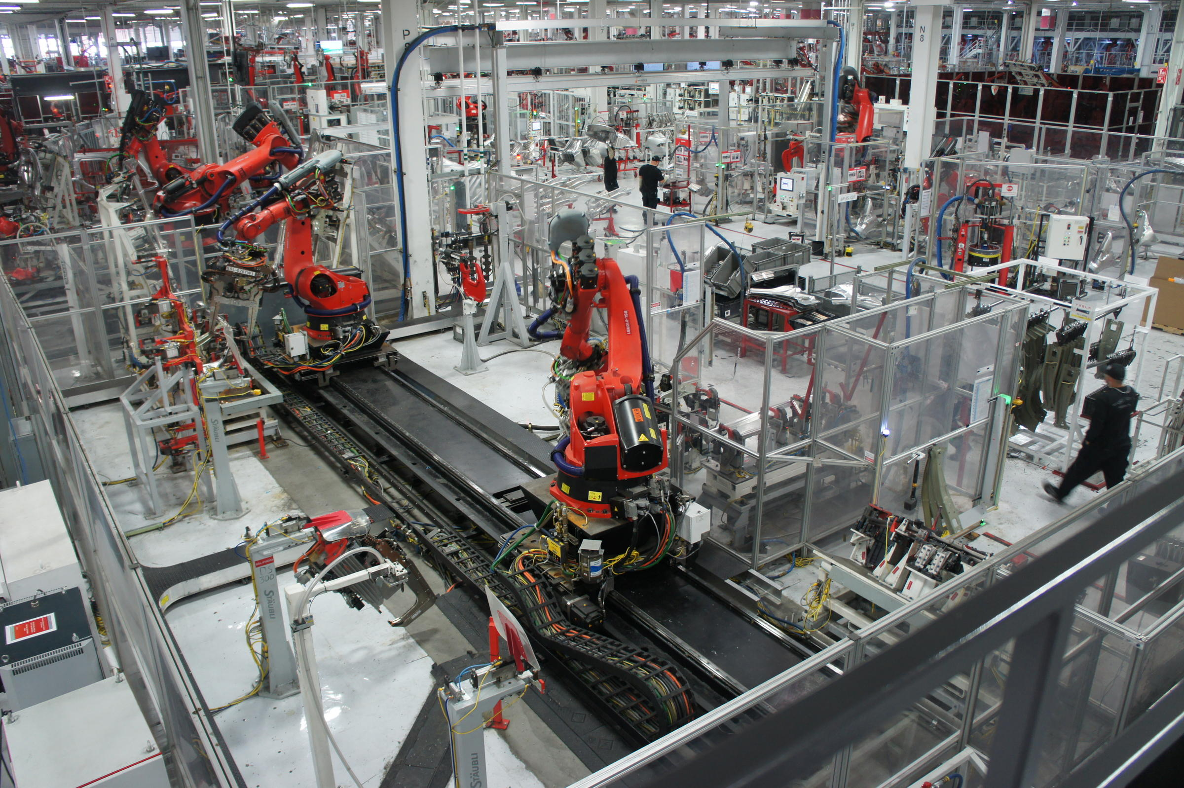 A publicity still from the Tesla Factory's interior, showing the high degree of robotic automation in the plant. Despite the application of new technology, Tesla's current output remains only a fraction of NUMMI's.