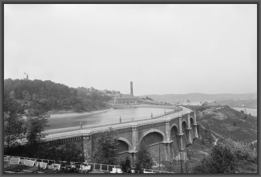 A 1901 photo of Eden Park's reservoir, which has since been removed.  Station no. 7 and the Ohio River can be seen in the background.