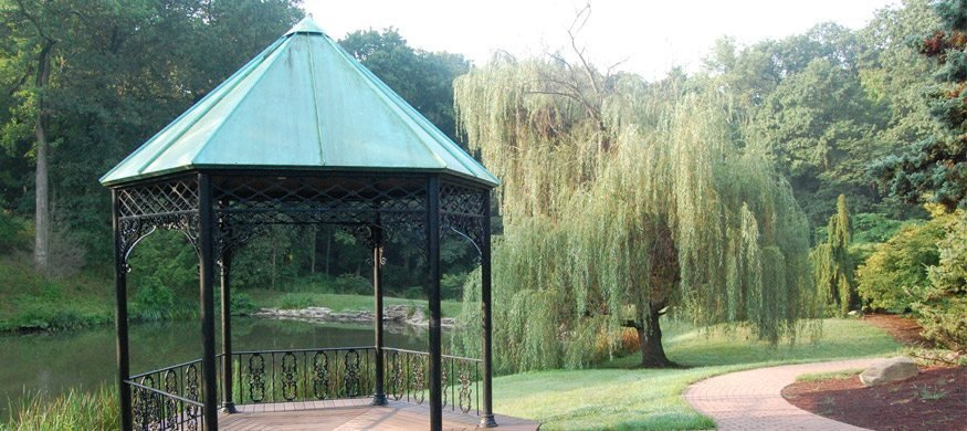 A gazebo sits beside a pond within Mount Airy's Arboretum.