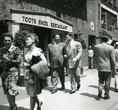 "Bernard ""Toots"" Shor walking outside of his restaurant on West 51st St. with New  York Yankees legend Joe DiMaggio"